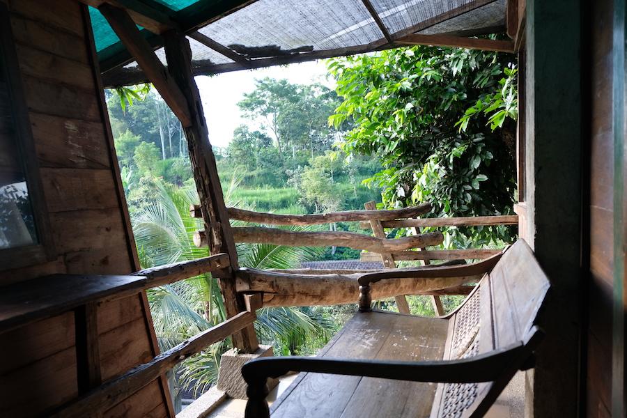 heytheregrace.com | Kampung Lumbung Boutique Hotel, Batu, Malang | kursi santai di depan kamar omah pohon